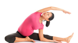http://www.dreamstime.com/stock-image-pregnant-woman-yoga-position-seated-side-stretch-prenatal-full-length-asian-doing-exercising-stretching-fullbody-isolated-white-image32465761